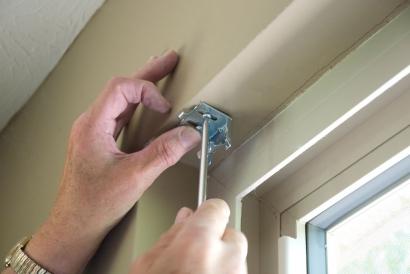 bigstock-installing-blinds-19169405